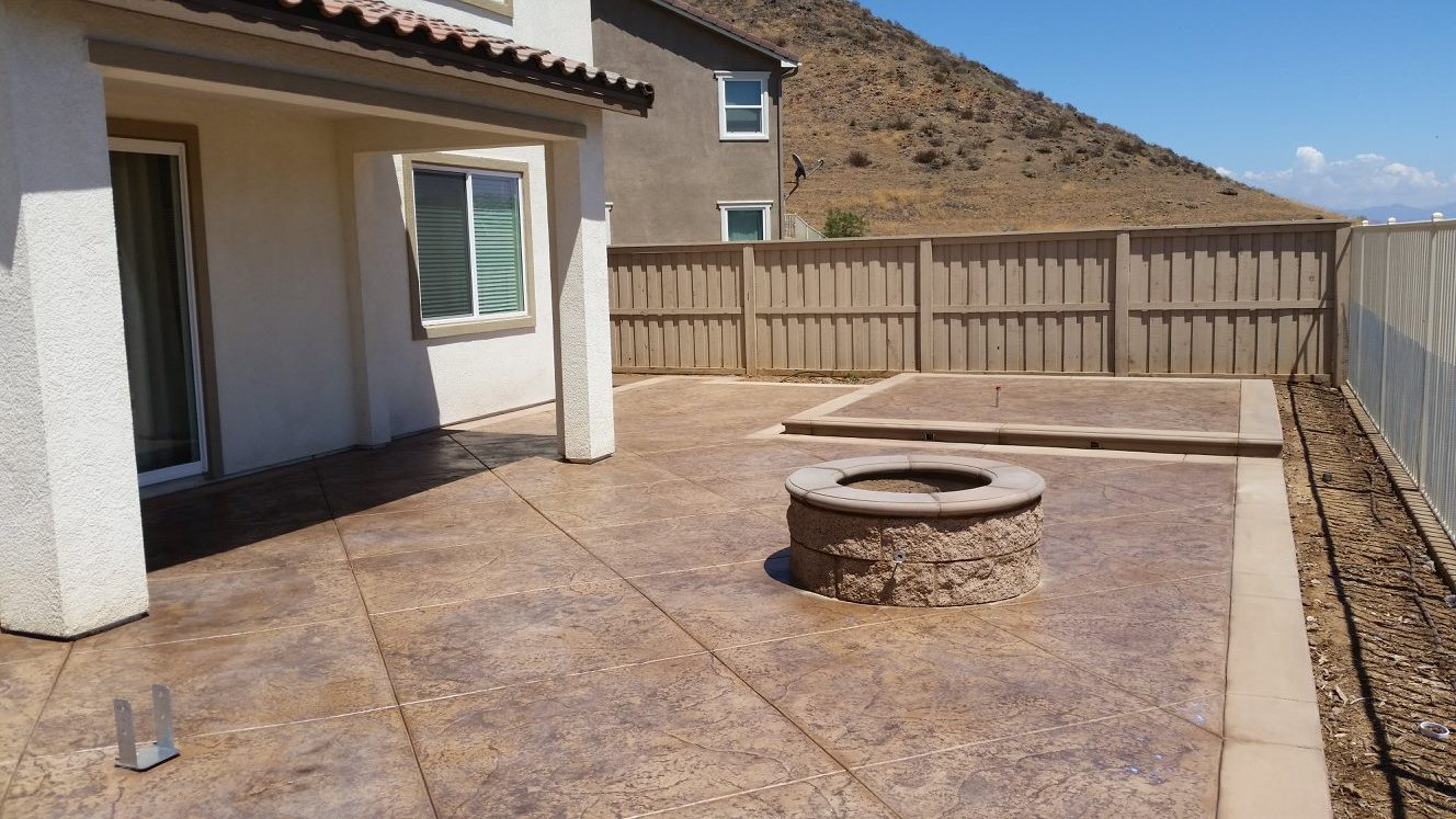 This is a concrete patio we installed with sandstone coloring